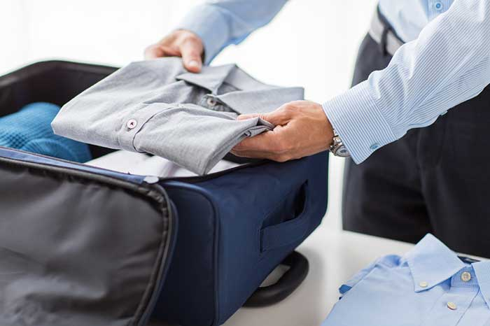 shutterstock_269613464-how-to-fold-dress-shirts-for-travel-1